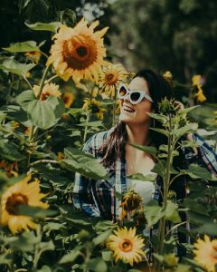 bookabin-youg-woman-sunglasses-sunflowers-australia