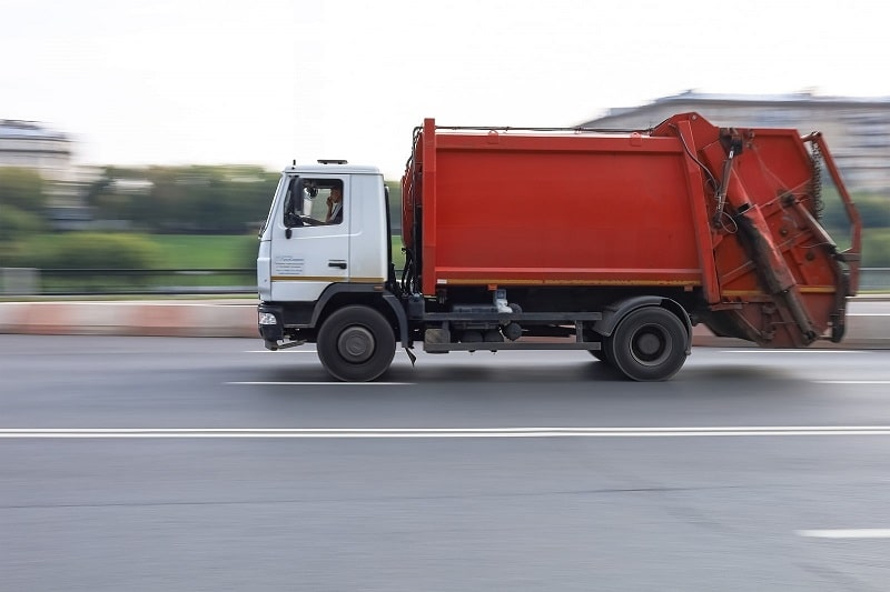 Rubbish truck heading to waste transfer station
